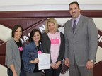 American Income SGA Scott Rehberg presents a check to Paiges Princess Foundation's Danielle Gingrich, Heather Alessandro (founder), and Wendy Mockabee
