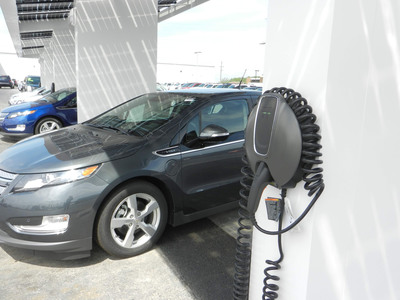 A Chevy Volt is Charged at the Solar Charging Station in Joliet. The Station can Accommodate up to Six Volts at once.  (PRNewsFoto/Bill Jacobs Joliet)