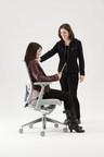 Teresa A. Bellingar, Ph.D., senior corporate ergonomist with Haworth (standing), offers ergonomics tips to help avoid 'Tech Hunch.'