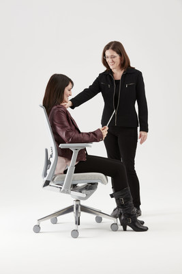 Teresa A. Bellingar, Ph.D., senior corporate ergonomist with Haworth (standing), offers ergonomics tips to help avoid 'Tech Hunch.'
