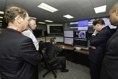 DOE representatives look into the brain of the intelligent grid at CenterPoint Energy's technology center.