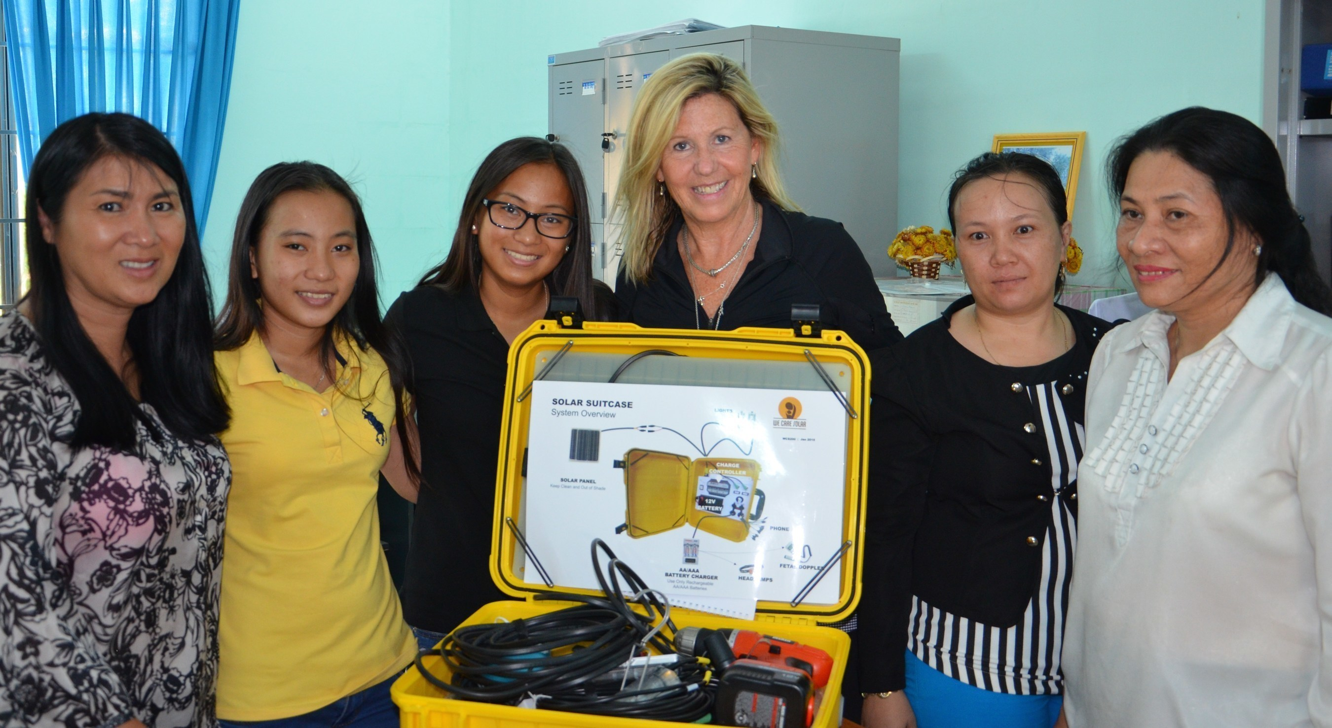 Keely Solimene of Bella | Ha, alongside twins, Isabella and Ha deliver the first Solar Suitcase to a remote clinic in the Khanh Hoa province of Vietnam.