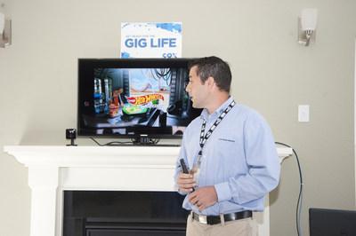 Cox Technician Joe Griffen demonstrates Gigabit Internet speeds inside a model home at Viridian Reserve at Hickory in Chesapeake, Va.