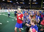 Kimberly Guy, president of St. Joseph's Children's Hospital in Tampa, leads the 18th Annual Kids Are Heroes nominees onto the field during the Tampa Bay Storm vs. the Orlando Predators halftime at the Amalie Arena July 11, 2015.