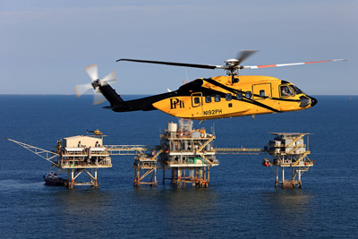 "PHI Inc. has completed the first operational flights of the new ""Rig Approach"" system, a first-of-its-kind functionality on the S-92(R) helicopter that provides helicopter operators with an automated approach to offshore rigs and platforms. Rig Approach allows for more consistent operations under challenging weather and operating conditions. (PRNewsFoto/Sikorsky Aircraft Corporation)"