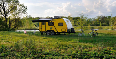 The 2013 Winnebago Minnie trailer is a new light weight, price conscious offering from Winnebago Industries and available in a fresh new lemon exterior color.  (PRNewsFoto/Winnebago Industries, Inc.)