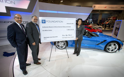 General Motors Vice President Global Design Ed Welburn (left) and GM Foundation President Vivian Pickard (right) present the GM Foundation's $1 million grant for the creation of the Smithsonian Museum of African American History and Culture to Founding Director of the Smithsonian Museum of African American History and Culture Lonnie Bunch Wednesday, January 22, 2014 in the Chevrolet exhibit at the Washington Auto Show in Washington, DC. Also on stage is the 2014 North American Car of the Year - the Corvette Stingray. (Photo by Mark Finkenstaedt for General Motors). (PRNewsFoto/General Motors Foundation) (PRNewsFoto/GENERAL MOTORS FOUNDATION)