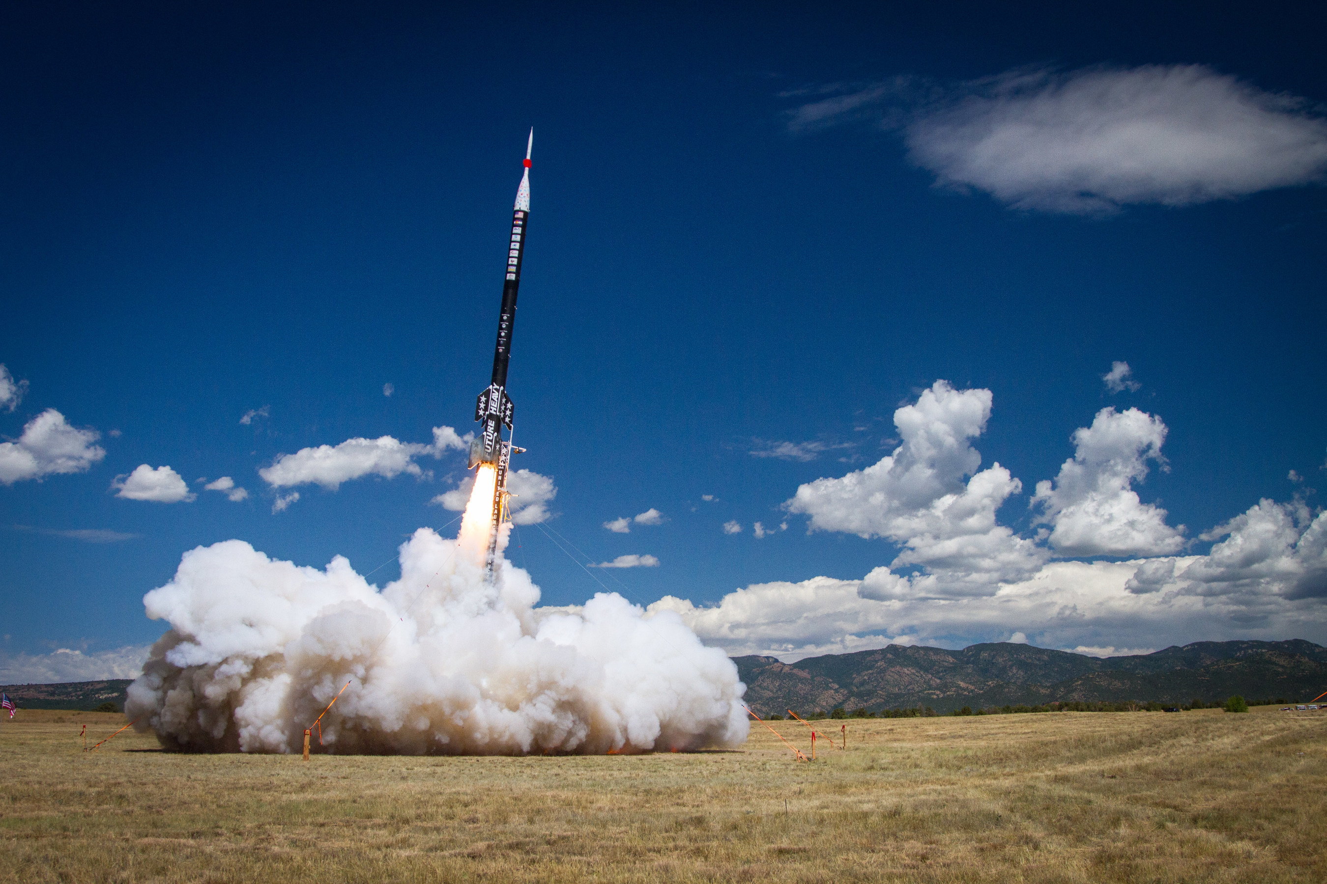 The Future Heavy rocket, built by interns across ULA, blasts off from Fort Carson, Colorado, carrying payloads built by interns at Ball Aerospace as well as K-12 students from across Colorado. At 50 feet tall, the ULA intern-built Future Heavy is the largest sport rocket ever to launch in the world.