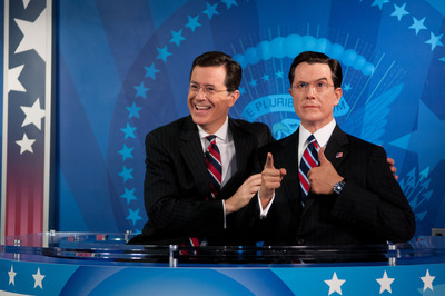 Comedy Central's Emmy Award-winning host, Stephen Colbert, reacts to seeing his wax figure for the first time at Madame Tussauds Washington D.C. on Friday, November 16, 2012.  Colbert helped unveil his wax likeness in the attraction's Media Room, which was renovated to include a replica set of The Colbert Report.  (PRNewsFoto/Madame Tussauds Washington D.C., Trevor Pound for M)
