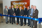 Omnitracs' CEO John Graham, its executive team and Dallas Mayor Mike Rawlings cut the ribbon to officially welcome the company to downtown Dallas