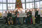 Stater Bros. President & COO Pete Van Helden along with other company executives present a check to the United States Marine Corps Toys for Tots on December 8, 2014.
