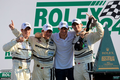 PR Newswire-supported racer Dion von Moltke celebrates the Daytona 24hr win with teammates.  (PRNewsFoto/Dion von Moltke)