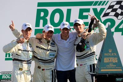 PR Newswire-supported racer Dion von Moltke celebrates the Daytona 24hr win with teammates.  (PRNewsFoto/Dion von Moltke)