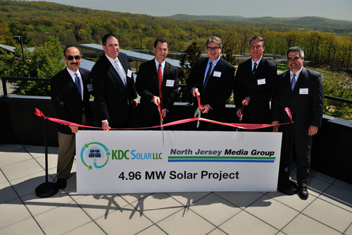 Left to right - Alan Epstein, President and COO, KDC Solar, Tom Lynch, Executive VP, KDC Solar, Hal Kamine, CEO, KDC Solar, Stephen Borg, President North Jersey Media Group, Thomas Heffernan,  Executive VP and CFO, North Jersey Media Group, Bob Konig, Vice President of Circulation and Operations, North Jersey Media Group.  (PRNewsFoto/KDC Solar LLC)