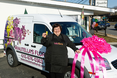 "Brookhaven, PA (Delaware County) Floral Shop Owner Michelle Florio of Minutella's Florist receives the keys to a brand new custom-wrapped floral delivery van from Teleflora ""Score Big & Win Bigger"" promotion. (Photo Courtesy of Mark Stehl of AP Images for Teleflora.)  (PRNewsFoto/Teleflora)"