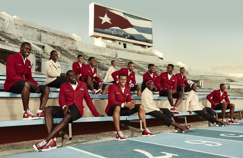 Christian Louboutin and SportyHenri.com Official Supplier of Cuban National delegation celebratory outfit for Rio Olympic Games. Cuban Athletics Team Members at Estadio Panamericano beneath flag, Havana, Cuba. (PRNewsFoto/Christian Louboutin)