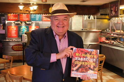 Roland Dickey, Sr. visits Dickey's Barbecue Pit in Mobile on Thursday to kick off the grand opening celebration and hand out 150 copies of his cookbook.