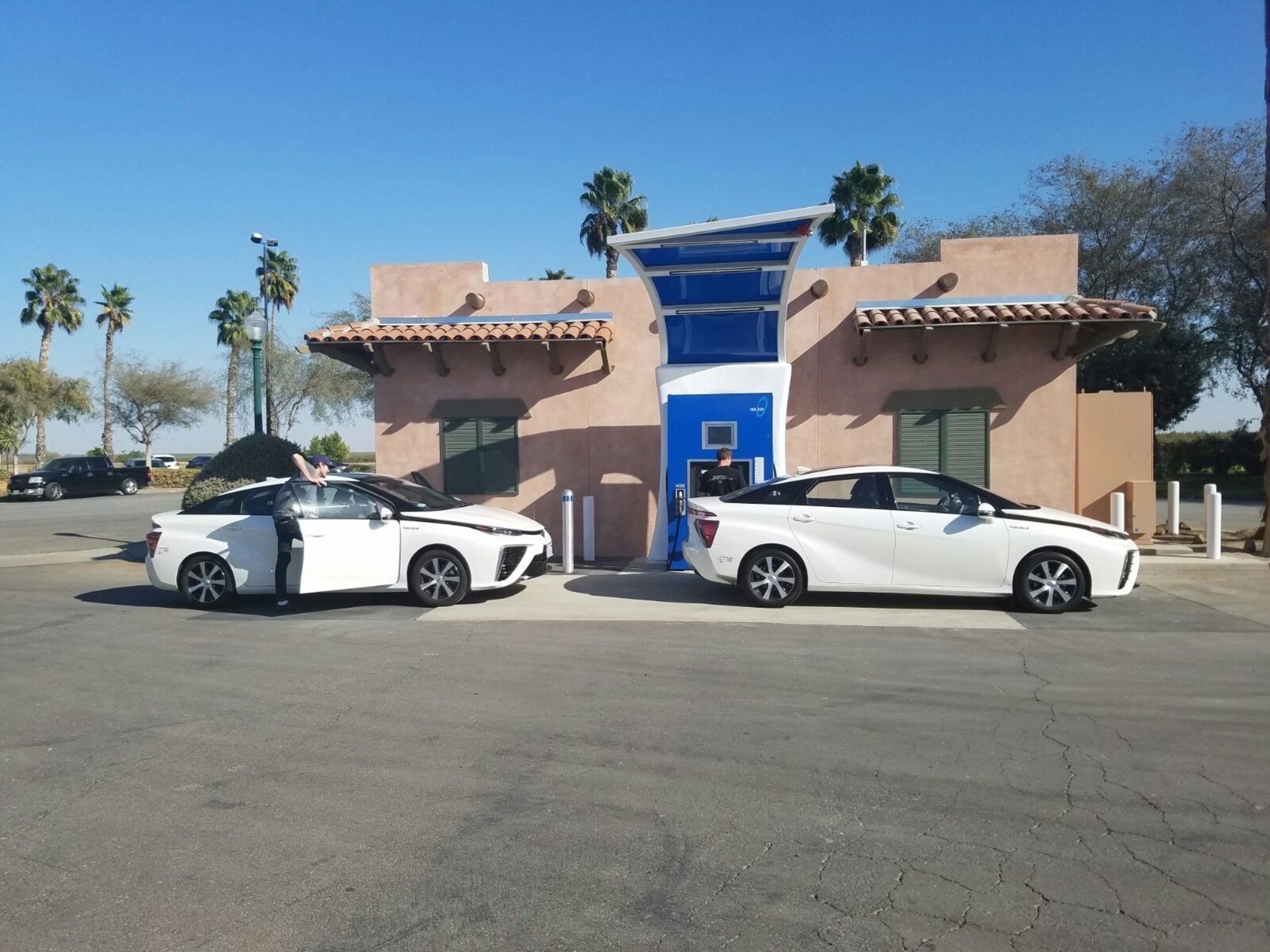 A pair of Toyota Mirai electric fuel-cell cars at the True Zero hydrogen-charge station at Harris Ranch, Coalinga, Calif. True Zero's hydrogen has powered FCEVs to more than two million emission-free miles.