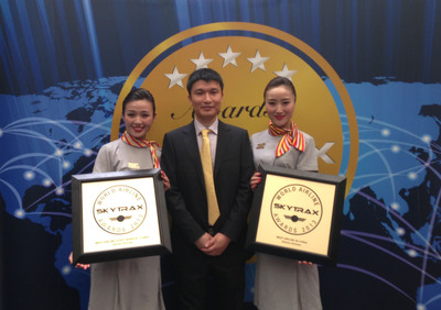"""Hainan Airlines Vice President Xie Haoming (center) accepts SKYTRAX's awards for """"Best China Airline""""� and """"Best China Airline Staff Service""""� at the Paris Air Show on June 18, 2013.  (PRNewsFoto/Hainan Airlines)"""