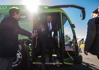 US Transportation Secretary Anthony R. Foxx disembarks from an electric bus during a visit to the International Transportation Innovation Center. Foxx was there to observe some of the latest automated vehicle technology in development.