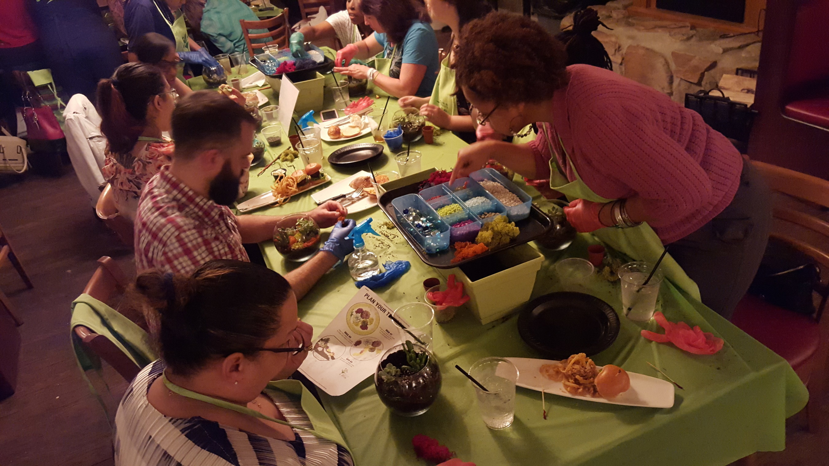 Families of injured service members learn how to create a terrarium.