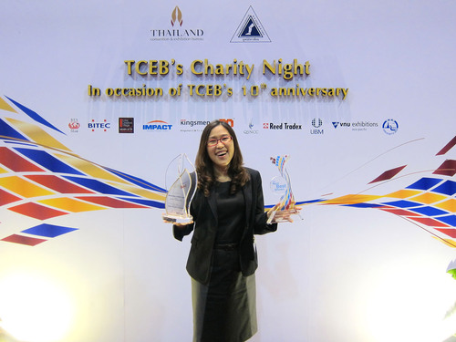 Nucharin Paradeevisut, General Manager of UBM Asia (Thailand) with the two awards.  (PRNewsFoto/UBM Asia)