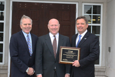 Martin Golden, Columbus District Director of the U.S. Small Business Administration (center) presents Ronald Seiffert, President and CEO of the Delaware County Bank (right) and Mark Shipps, Vice Chair of the Board of Directors of the Delaware County Bank (left), a plaque to commemorate DCB's selection as Preferred Lender status under the SBA's Preferred Lender Program.