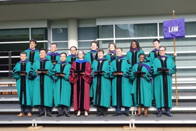 Washington University in St. Louis School of Law's First Graduating Class of Online LL.M. Students at the St. Louis graduation ceremony with Dean Nancy Staudt.