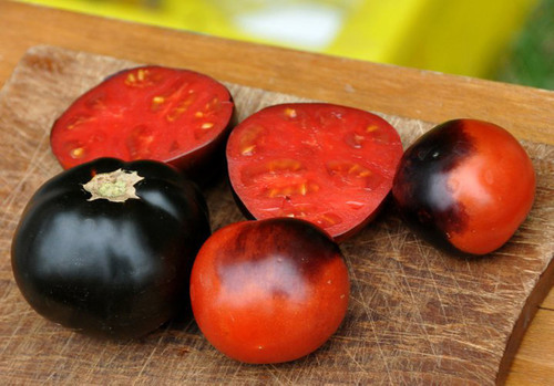Mighty 'Mato Heirloom Tomatoes - Indigo Apple.  (PRNewsFoto/Mighty 'Mato)