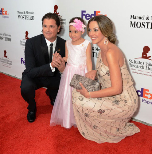 Carlos Vives and wife next to St. Jude patient Izarah at Miami Gala.  (PRNewsFoto/St. Jude Children's Research Hospital)