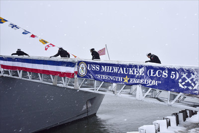 Sailors assigned to the Freedom-variant littoral combat ship USS Milwaukee (LCS 5) man the ship during the commissioning ceremony in snowy Milwaukee, Wisconsin, Nov. 21. Milwaukee will proceed to her homeport in San Diego next year. Photo credit: Lockheed Martin