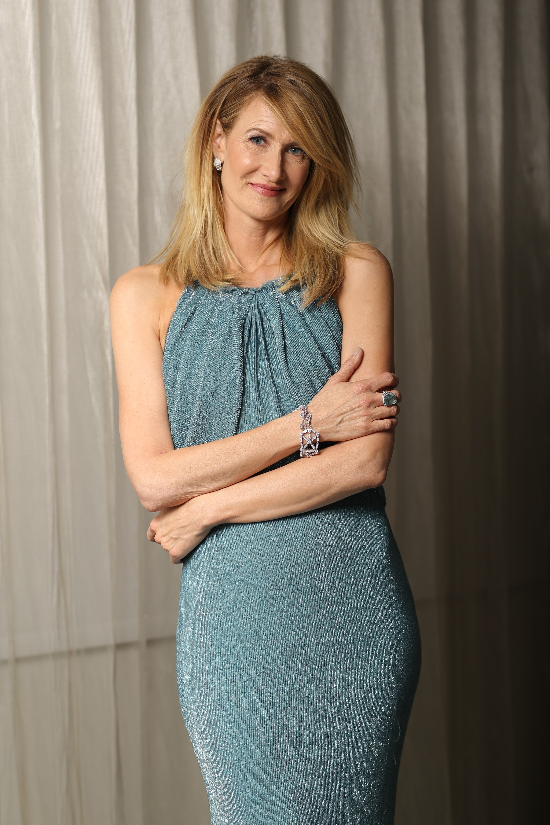 Best Supporting Actress nominee Laura Dern continues the Oscars(R) celebration by slipping into a turquoise ...