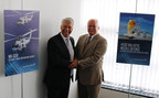 Peder Pedersen (left), chief executive officer of Weibel Scientific A/S, and Brad Hicks (right), vice president of Integrated Warfare Systems and Sensors at Lockheed Martin, participated in a signing ceremony marking the launch of a new partnership between Lockheed Martin and Weibel Scientific to extend ballistic missile defense capabilities.