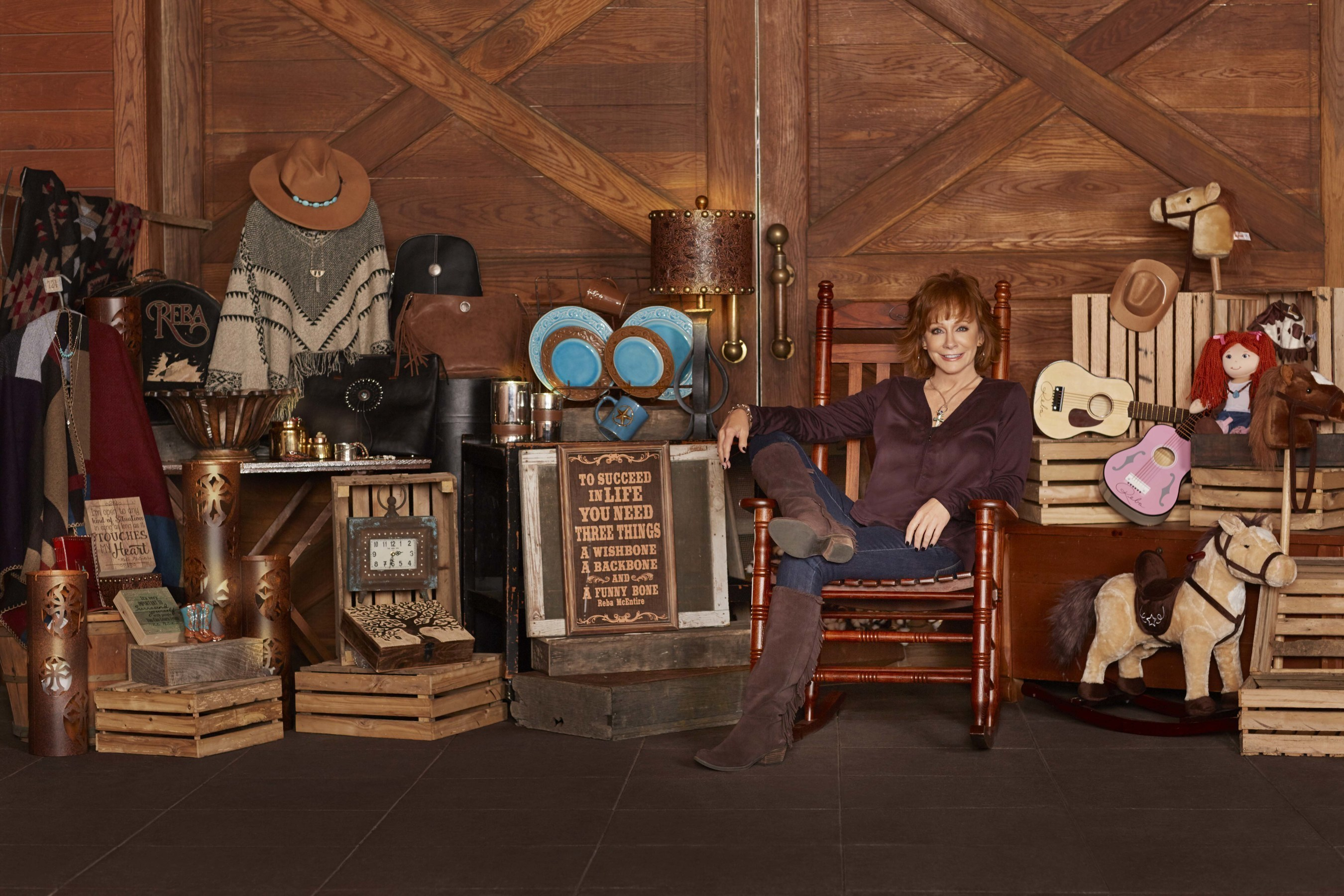 "Reba McEntire's retail line, ""Rockin' R By Reba,"" is available exclusively at Cracker Barrel Thursday, August 4, 2016 and features specialty items designed by the singer and inspired by her life and interests."
