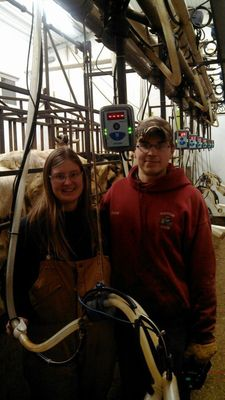 Jason and Clare Heberlein from Fennimore, WI in their milking parlor (PRNewsFoto/Afimilk Ltd)