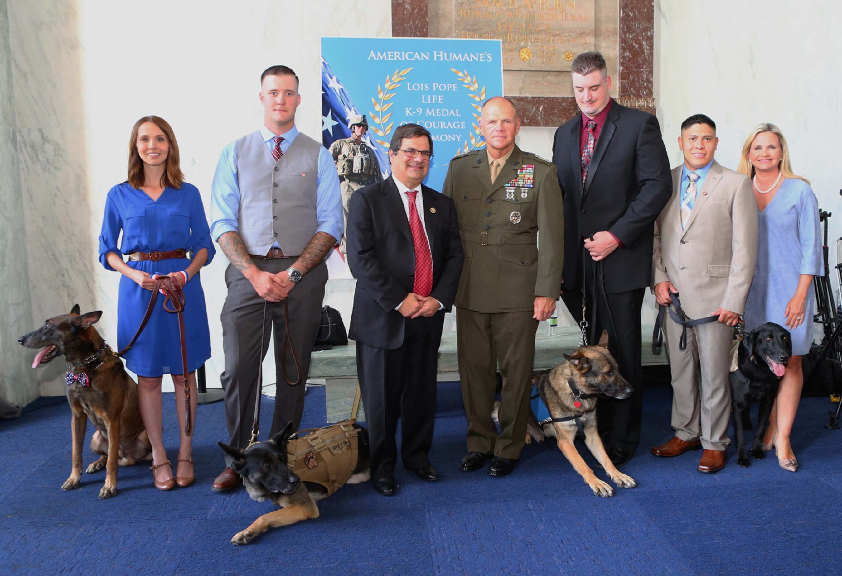 HONORING OUR K9 MILITARY HEROES (left to right): MWD Bond, Sarah Browning, Sgt. Wess Brown, MWD Isky, Congressman Gus Bilirakis, General Robert B. Neller, MWD Matty, Spc. Brent Grommet, Corp. Nick Caceres, CWD Fieldy, American Humane President Dr. Robin Ganzert