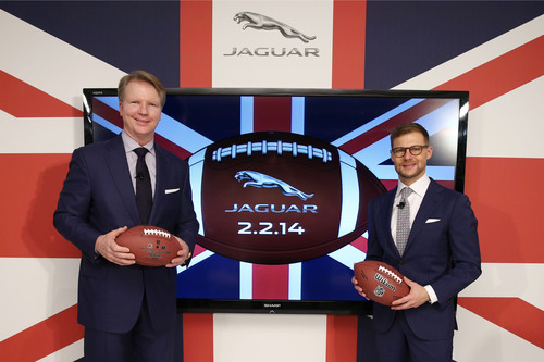"Phil Simms, CBS sports lead NFL analyst and Super Bowl XXI MVP, joined Jeff Curry, Brand Vice President, Jaguar North America, to announce Jaguar's first television commercial for broadcast in the Super Bowl, at The London NYC in New York City on November 7, 2013.  The spot is part of a new brand and product advertising campaign, themed ""British Villains,"" for the launch of the new Jaguar F-TYPE Coupe.  (PRNewsFoto/Jaguar)"