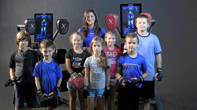 Kids line up to try the new Nexersys child's mode. The Nexersys child's mode included in the 1.4 software release, disables the top two pads. This allows children ages 14 years and below to compete in Avatar Follow Me, Avatar Sparring, and Multiplayer Competition rounds. This new release allows the entire family to focus on fitness.