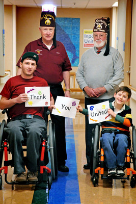Gary Johnson (upper left) and Bob Nichols (upper right), both of the Elf Khurafeh Shrine Center in Clio, Mich., with Shriners Hospitals patients Chris Salmon of Tiptonville, Tenn. (lower left), and Strother Norman of Fort Worth, Texas (lower right).  Salmon and Norman have benefited from transportation services offered by their local Shriners Fraternity. The miles awarded through the United 10 Million Charity Miles Giveaway will greatly assist patients like Salmon and Norman, providing smooth travel to and from Shriners Hospitals.  (PRNewsFoto/Shriners)