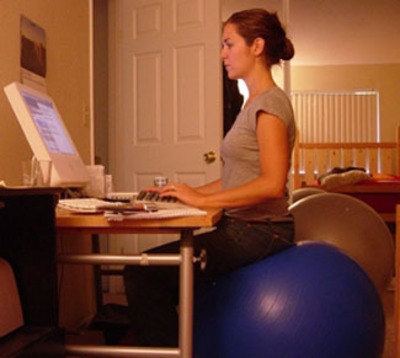 Standard exercise ball used as a chair.  (PRNewsFoto/Gemini Media)
