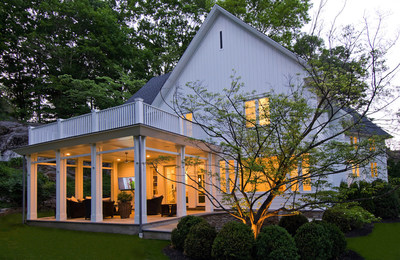 """Side exterior of """"The Greenwich House"""" featuring a new level of outdoor living complete with built in speakers and outdoor TV for great get togethers around movies and sporting events."""