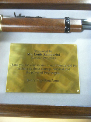 Henry Repeating Arms honors Louis Zamperini, World War II Hero, with a custom Military Service Tribute Rifle and dedication plaque thanking him for his service to the USA, and for teaching us about courage, survival and forgiveness.    (PRNewsFoto/Henry Repeating Arms)