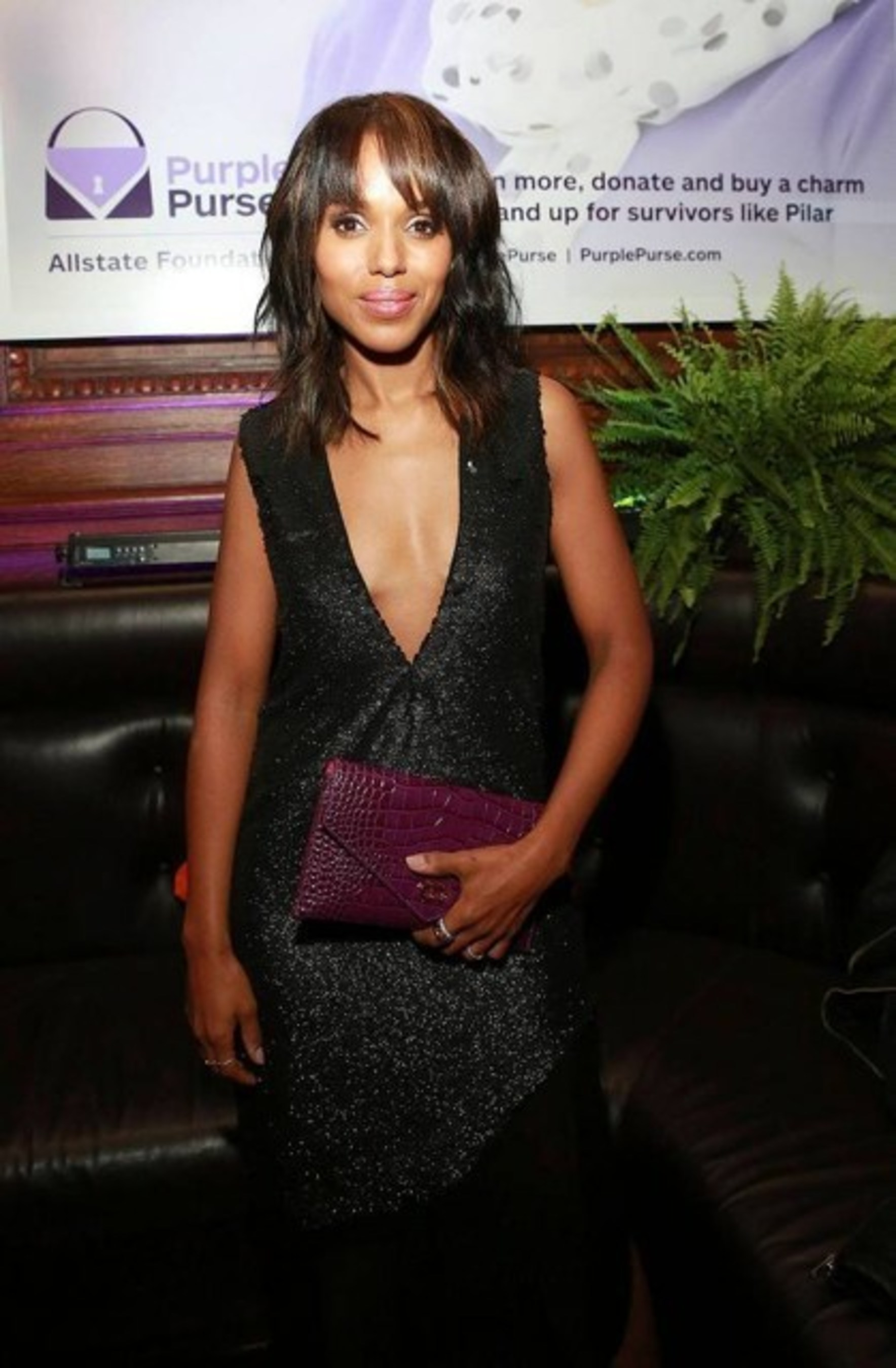 Allstate Foundation Purple Purse Ambassador Kerry Washington and the limited-edition purse (purchase at saks.com)