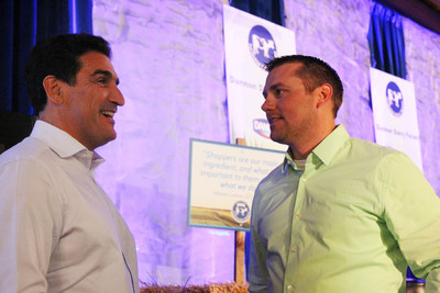 Dannon CEO Mariano Lozano, left, discusses alternative farming practices to provide more consumer choices with fourth-generation dairy farmer and Dannon supplier Ken McCarty, right, of McCarty Family Farms