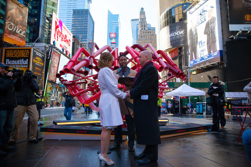 Times Square Celebrates Valentine's Day With Surprise Proposals, Live Weddings And Vow Renewals