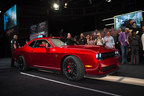 This one-of-a-kind 2015 Dodge Challenger SRT Hellcat VIN0001, hand painted Stryker Red, sold for $825,000 at the Barrett-Jackson Auction in Las Vegas this weekend, with all proceeds going to benefit not-for-profit charity, Opportunity Village. The Las Vegas-based Engelstad Family Foundation matched the auction price, bringing the total raised from the Dodge Challenger SRT Hellcat auction to $1.65 million. (PRNewsFoto/Chrysler Group LLC)
