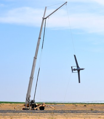 Insitu's Integrator unmanned aircraft recovers via SkyHook; the aircraft recently completed a 24-hour endurance flight. (PRNewsFoto/Insitu)