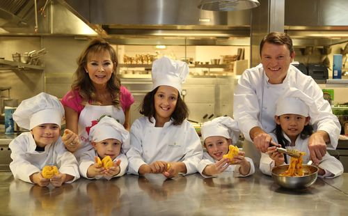 Children's food expert, Annabel Karmel MBE and award-winning chef, Theo Randall, work with the *real* experts to ensure the new InterContinental Hotel & Resorts Children's Menu passes the high standards of their junior guests. The new menu promises to take children through an exciting journey of food discovery and will be rolled out worldwide from January 2014. (PRNewsFoto/InterContinental Hotels Group)