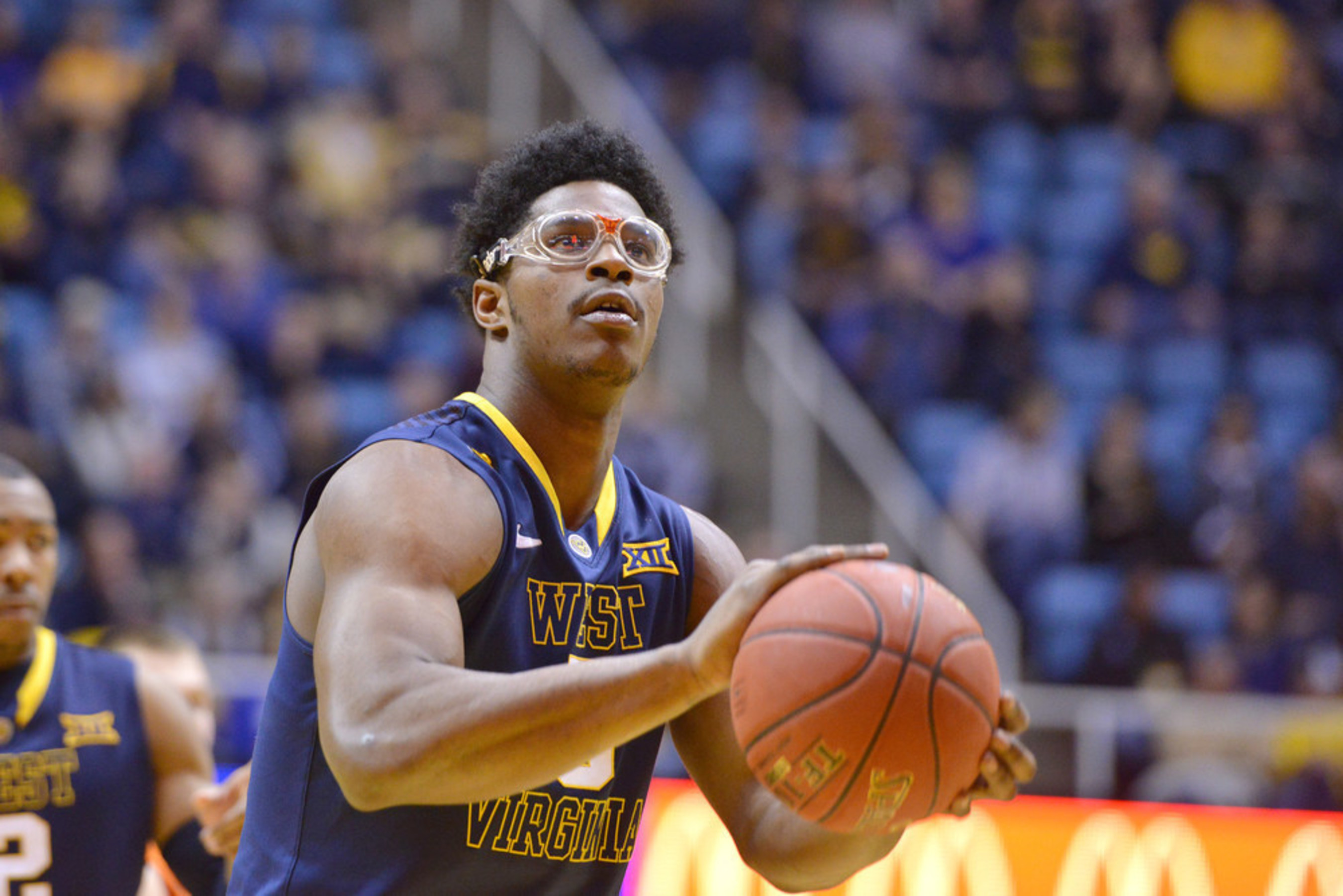 West Virginia college basketball player Devin Williams is known for his goggles. Protective eyewear like his can cut the risk of sports eye injury significantly.