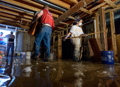 Lowe's employee volunteers cleaned out flooded basements and garages to help dozens of homeowners with their recovery efforts.  (PRNewsFoto/Lowe's)